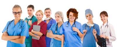 八个人兴高采烈的医疗队  免版税库存照片