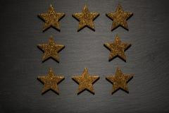 八个金黄星框架  库存照片