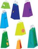八个购物袋变化的大小和颜色 免版税库存图片