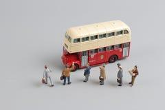 公共汽车形象玩具有白色背景 库存图片