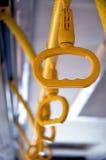 公共汽车把柄黄色 库存照片