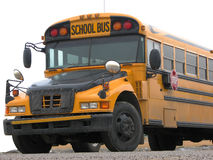 公共汽车末端前面学校 免版税库存图片