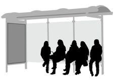 公共汽车站妇女 库存照片