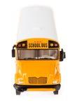 公共汽车:在白色隔绝的校车玩具 图库摄影