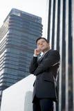 公司户外画象可爱的商人周道在商业区 图库摄影