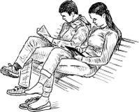 公园长椅的学生 免版税图库摄影