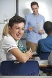 公少年学生画象在类的 库存照片
