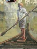 公开街道艺术在乔治城'有一支桨的老人在小船'槟榔岛,马来西亚 免版税图库摄影