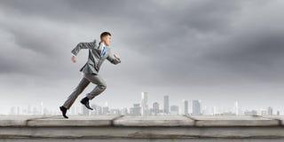 公文包企业生意人竞争概念运行中 免版税图库摄影