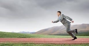 公文包企业生意人竞争概念运行中 库存照片