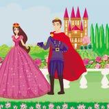 公主和王子在一个美丽的庭院里 库存图片