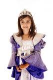 公主成套装备微笑的逗人喜爱的年轻深色的女孩 免版税库存图片