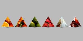 六座抽象金字塔充满果子 免版税库存照片