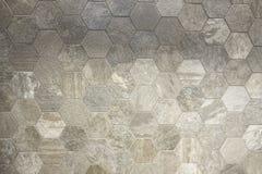 六角星形塑造了瓦片,土质色的使有大理石花纹的textued背景表面 库存图片