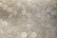 六角星形塑造了瓦片,土质色的使有大理石花纹的textued表面 库存图片