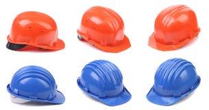 六顶蓝色和红色安全帽 免版税库存照片