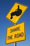 共享标志拖拉机 免版税库存照片