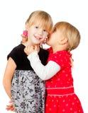 共享秘密的小女孩 免版税图库摄影