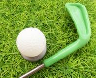 关于学会高尔夫球比赛的有趣的背景与俱乐部的 免版税库存图片