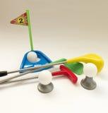 关于教高尔夫球比赛的背景与玩具高尔夫球集合的 库存照片