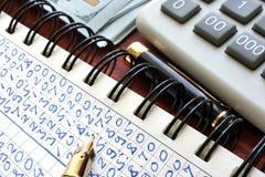 关于笔记的收入报告 库存照片