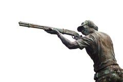 关于运动员的古铜色公开雕塑射击枪,空白的文本 免版税库存照片
