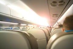 关于运输和旅途的抽象概念性照片 在客舱的乘客座位与sunlights 免版税库存图片