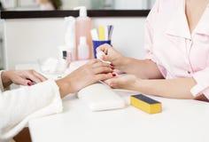 关心棉花取消拖把油漆的指甲盖钉子 库存照片