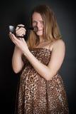 关键低做妇女年轻人的照片怀孕 免版税库存图片