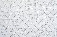 关闭一个白色七巧板的纹理在被装配的情况的 顶视图 大整个马赛克的许多组分被团结 图库摄影