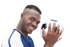 关闭一位微笑的英俊的足球运动员的画象 免版税库存图片