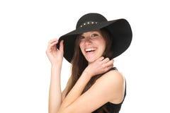 关闭一名微笑的妇女的画象有黑帽会议的 库存照片