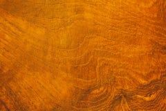 关闭与五谷纹理的土气木桌在葡萄酒样式 免版税图库摄影