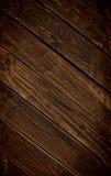 黑暗的富有的木背景 库存照片