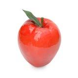 关闭人为苹果 隔绝在一白色backgropund 库存照片