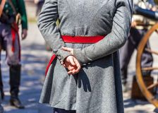 关闭人打扮作为阿拉摩之战的周年的19世纪战士 免版税库存照片