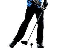 关闭人高尔夫球运动员打高尔夫球的剪影 图库摄影