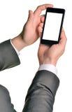 关闭使用流动巧妙的电话的人 免版税库存图片
