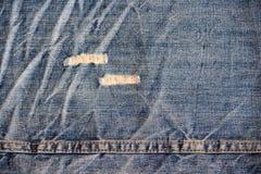 关闭使用的牛仔裤 免版税图库摄影