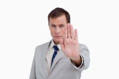 关闭信号化终止的生意人 免版税库存照片