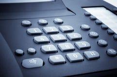 关闭办公室电话数字式块  库存照片