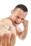 关闭反撞力猛击与表示的拳击手战斗机画象  免版税图库摄影