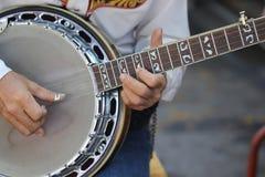 关闭吉他牛仔 免版税库存图片