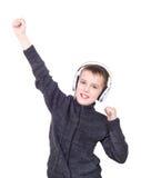 关闭听到与耳机的音乐的男孩画象 库存图片