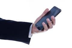 关闭商人的手使用流动巧妙的电话的 库存图片