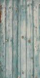 关闭土气被绘的木蓝色绿松石快门背景 库存图片