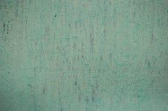 关闭在一个混凝土墙上的削皮油漆,破裂的油漆背景 免版税库存照片