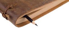 关闭在书的页的之间一支黑铅笔 图库摄影