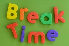 关闭在塑料l的五颜六色的断裂时间词 免版税库存照片