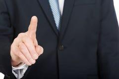 关闭在按抽象按钮的男性手指 库存照片